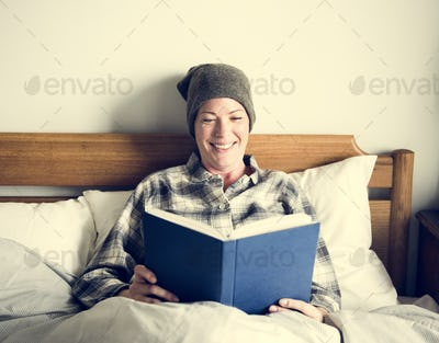 Patient reading in bed