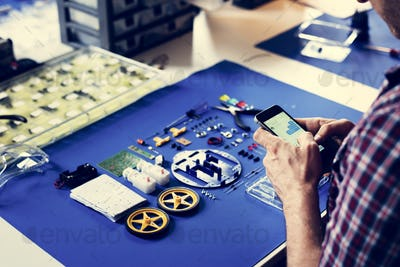 Tecnician hands texting message with robot tools on blue background