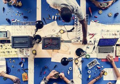 Aerial view of electronics technicians team