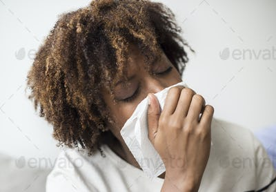Woman sick and sneezing