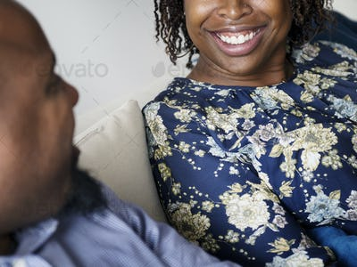 Black couple relaxing at home together
