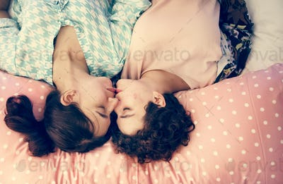 Lesbian couple sleeping on the bed together