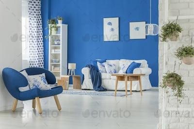 Dark blue armchair in flat
