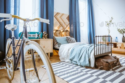 Bicycle in blue bedroom interior