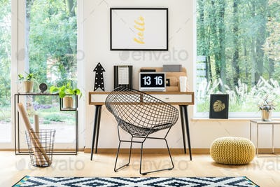 Yellow pouf in workspace