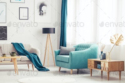 Living room with blue armchair