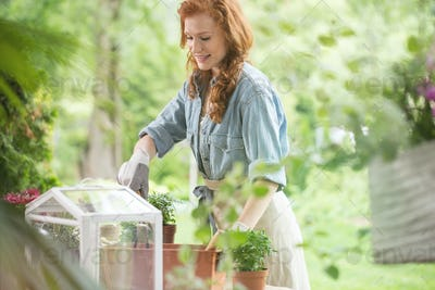 Happy girl planting flowers