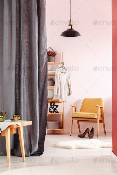 Dressing room with vintage armchair