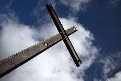 Iron cross and cloudy sky