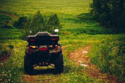 ATV Quad Bike in wild nature landscape