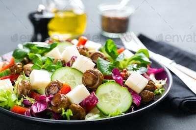 Fresh vegetable salad with mushrooms