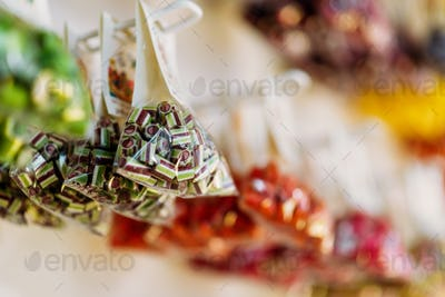 Colorful caramel sweets in transparent bags