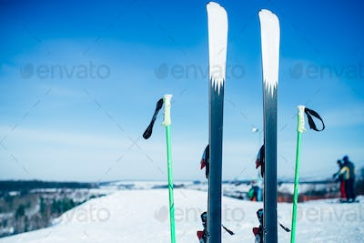 Skis and poles sticking out of the snow, nobody