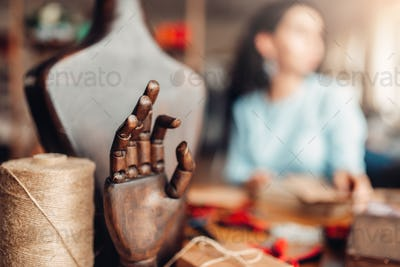 Needlework tools, wooden hand and mannequin,