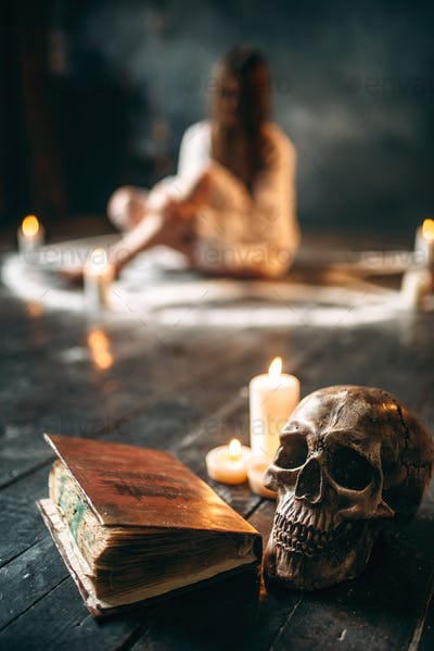 Human skull and spellbook,  occultism and exorcism