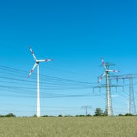 Wind engines and power supply lines on a sunny day