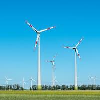 Modern wind turbines on a sunny day