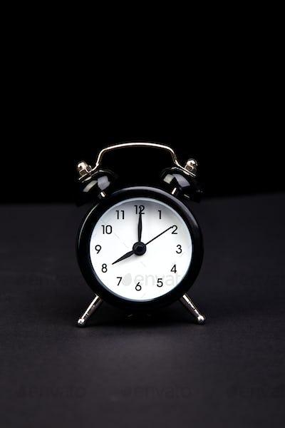 Black vintage alarm  clock.