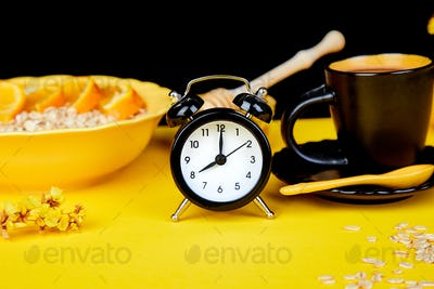 Morning coffee, granola breakfast, alarm clock