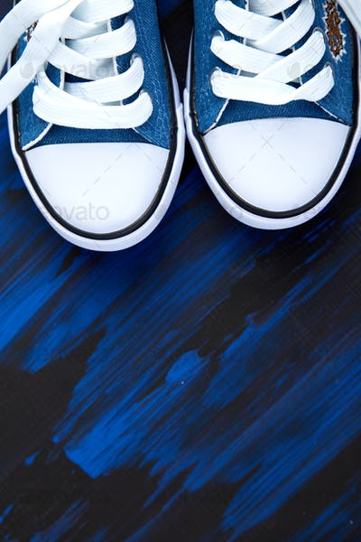 Flat lay of female or male sneakers shoes