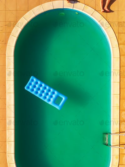 Aerial view of people relaxing by swimming pool