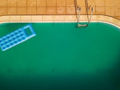 Aerial view of inflatable mattress in swimming pool