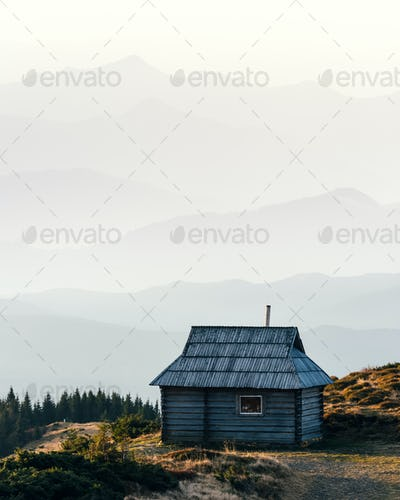 Mountain cabin during sunrise.