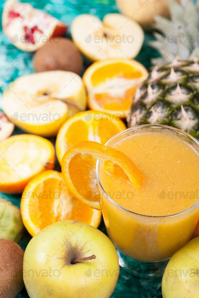 Detox smoothie surrounded by fruits it was made of