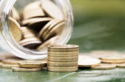 Retirement income concept - gold money coins