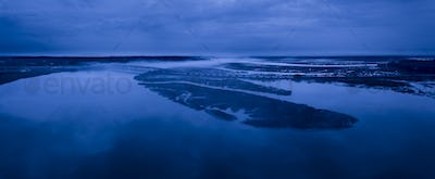 Night time aerial panorama of fog on a river