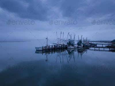 Low aerial view of shrimp boats in port in Port Royal, South Car