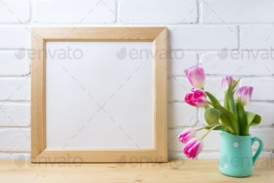 Wooden square frame mockup with pink tulip in mint pitcher vase