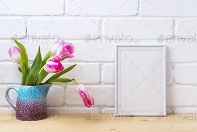 White small frame mockup with pink tulip in purple blue vase