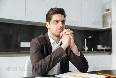 Concentrated young businessman working indoors