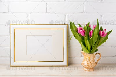 Gold decorated landscape frame mockup with bright pink tulips in