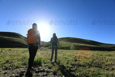 Two friends hiking in high altitude mountains