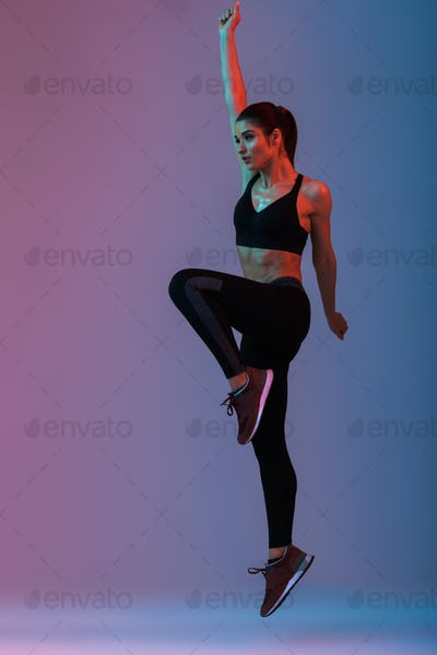 Full length portrait of slim wellbeing woman wearing black track