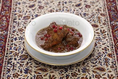 chicken fesenjan, pomegranate walnut stew, iranian persian cuisine