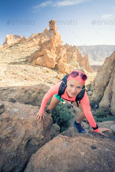 Woman hiker reached mountain top, summer activity