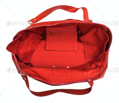 top view of open empty red travelling bag isolated