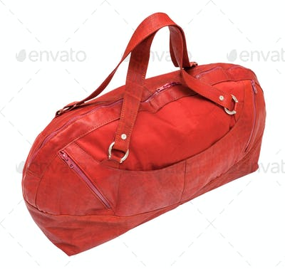 side view of closed red travel bag isolated