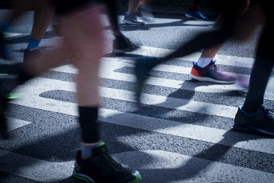 closeup on marathon runners legs and feet with motion blur