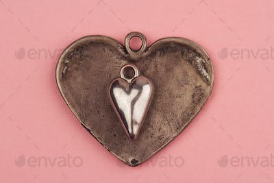 two vintage heart shaped jewels on top of each other