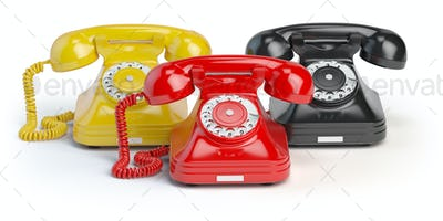 Group of  vintage telephones of differents colors isolated on wh