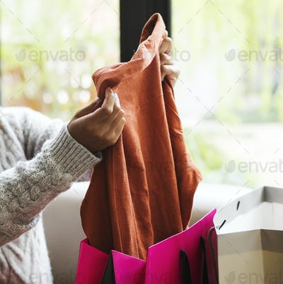 Woman unpacking a shopping bag
