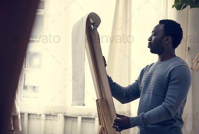 African man drawing