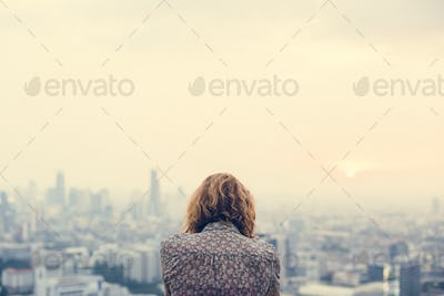 Blond woman at a rooftop