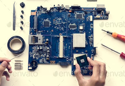 Aerial view of hands with computer components on white background