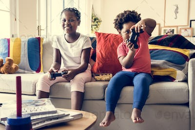 Siblings are playing game together