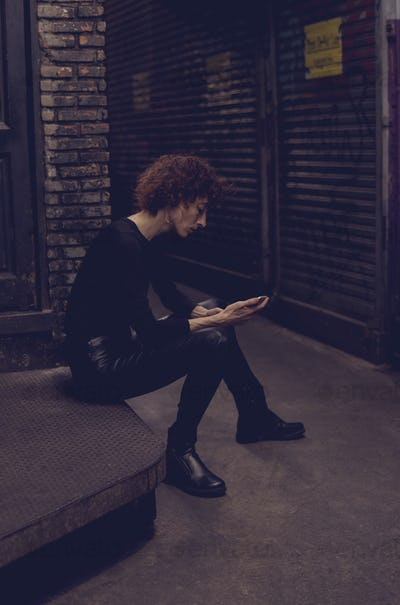 Woman waiting with mobile phone in hand